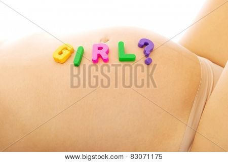 Belly of pregnant woman with girl lettering question