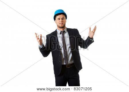Engineer in hard hat holding copyspace in both hands.