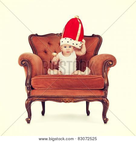 royalty and happy child concept - adorable royal baby boy in king hat with lollipop