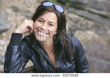 A 30 years old beautiful woman portrait in nature