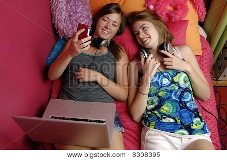 Teenagers Using Mobile Phone and Computer
