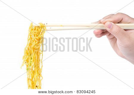 Hand With Chopsticks Clamp Chinese Wonton Noodles, Roast Pork And Vegetable Isolated On White Backgr