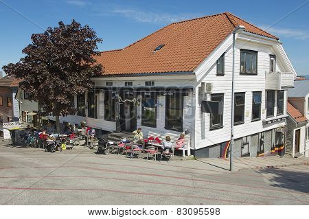 People relax in a cafe in downtown Stavanger in Stavanger, Norway.