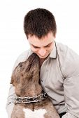 picture of pit-bull  - Portrait of a young man and a pit bull isolated on white background - JPG