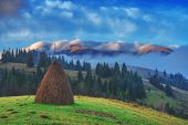 stock photo of haystack  - alone haystack in foggy mountain - JPG
