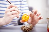 picture of ester  - young happy girl with brush and ester eggs for easter holiday - JPG