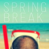 image of mask  - the text spring break written on a blurred image of a man with a diving mask and a snorkel - JPG