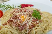 stock photo of carbonara  - Pasta Carbonara with tomato rosemary and basil leaves - JPG