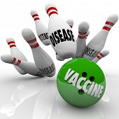 stock photo of bowling ball  - Vaccinate word on a bowling ball striking balls marked disease to illustrate stopping the spread of infectious disease through immunization - JPG