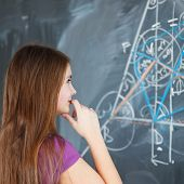 picture of math  - pretty young college student writing on the chalkboard - JPG