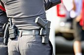 picture of guns  - Police man with the short gun and radio - JPG
