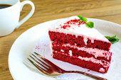 stock photo of red velvet cake  - Close up of Red velvet cake and coffee on wooden table - JPG