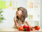 image of disgusting  - child girl with expression of disgust against vegetables - JPG