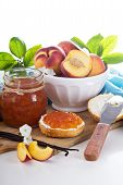 picture of peach  - Peach vanilla jam with fresh peaches on table - JPG
