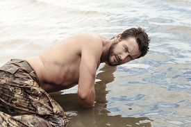pic of wet pants  - Close up Handsome Athletic Army with No Shirt Crawling at Sea Water While Looking at the Camera - JPG