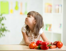 picture of disgusting  - child girl with expression of disgust against vegetables - JPG