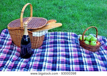 Picnic Hamper Basket, Champagne Wine Bottle, Fruits On The Blanket