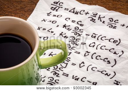 mathematical equations of physics - handwriting on a napkin with a cup of coffee