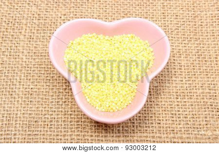Millet Groats In Pink Bowl On Jute Canvas