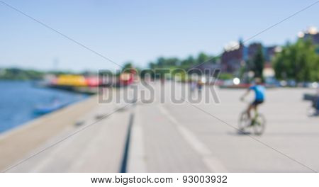 Blurry background - panoramic landscape of embankment at summer time