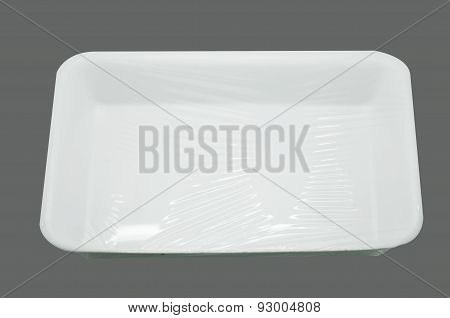Wrapped white styrofoam food tray
