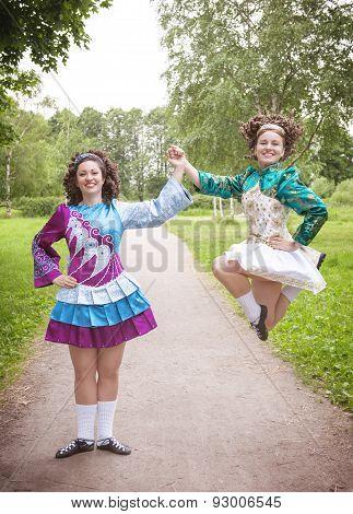 Two Young Beautiful Girls In Irish Dance Dress Dancing Outdoor