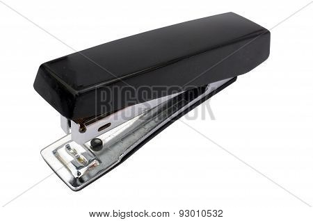 Black stapler stationary on white background