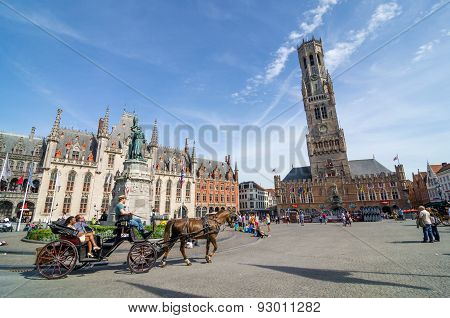Bruges, Belgium - May 11, 2015: Tourist On Grote Markt Square In Bruges.