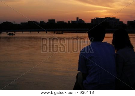 Lovers Watching The Sunset