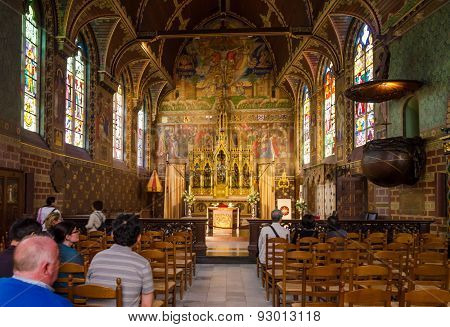 Bruges, Belgium - May 11, 2015: Tourist Visit Interior Of Basilica Of The Holy Blood In Bruges