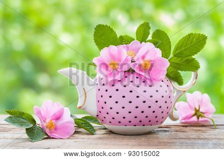 Tea Kettle With Bouquet Of Pink Wild Roses. Wedding Or Birthday Still Life.