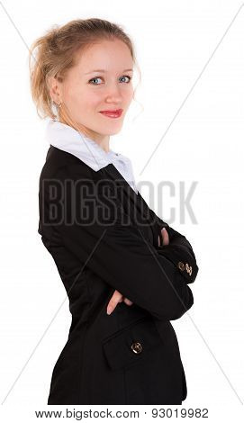 Cute woman in business suit standing  with crosswised arms