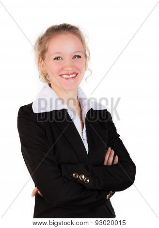 Smiling woman in business suit standing  with crosswised arms