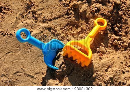 Blue Childrens Spatula And Yellow Rake, Stuck In Sand