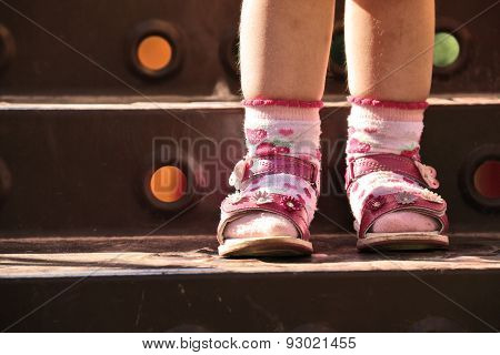 Baby Legs In Shoes And Socks, Standing On Step Of Stairs