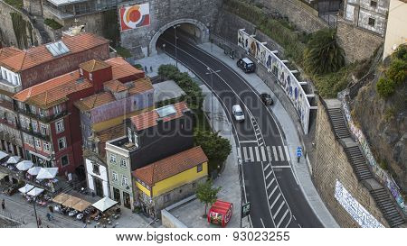 PORTO, PORTUGAL - JUNE 9, 2015: Ribeira, road and tunnel, top view from Dom Luis I Bridge in historic center of Porto. UNESCO recognised Old Town of Porto as a World Heritage Site in 1996.