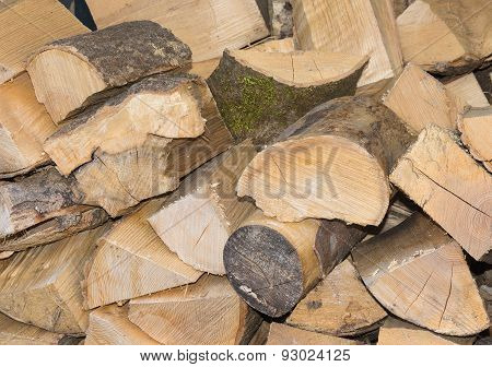 Wood Logs Cut And Stacked Ready For Use.