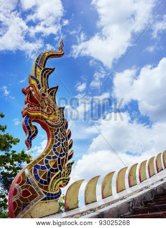king of naga in thai temple and blue sky background