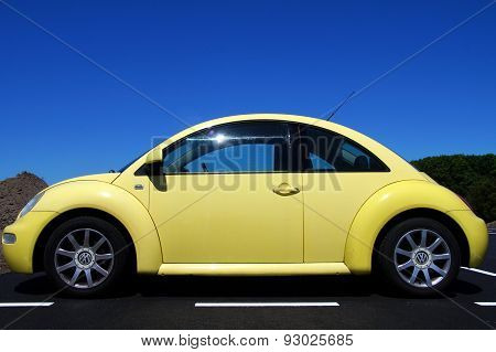 Yellow Volkswagen Beetle - side view