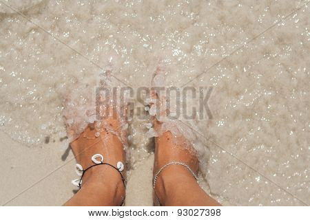 Woman's bare feet on the beach