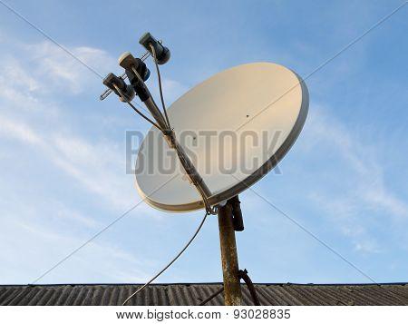 Satellite Dish Antenna Over Blue Sky Background