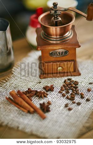 Wooden coffee grinder and ingredients for Turkish coffee