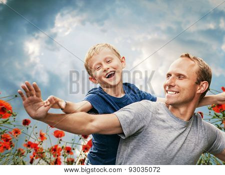 Happy Smiling Son And  Father Portrait Among The Poppies