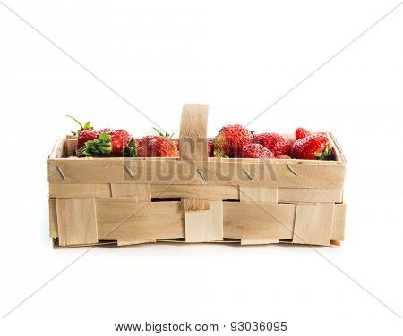 Strawberries in a basket isolated on a white background