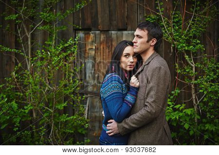 Amorous couple in casualwear having romantic date outside