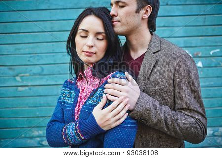Amorous young couple in casualwear