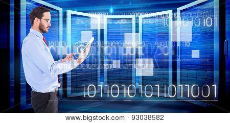 Businessman scrolling on his digital tablet against composite image of server room