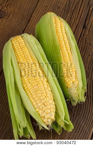 corn cob on old wooden background