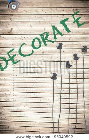 The word decorate against plugs on wooden background