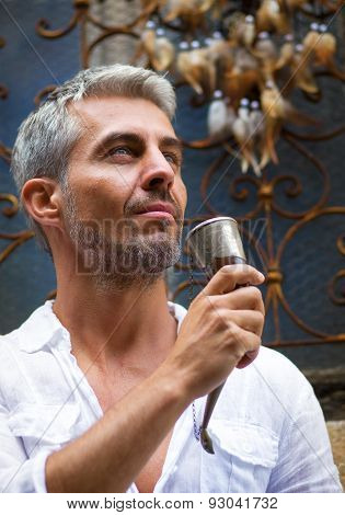Man Drinking Beer  And Medieval Mead Horn In Hand. Toast Concept.